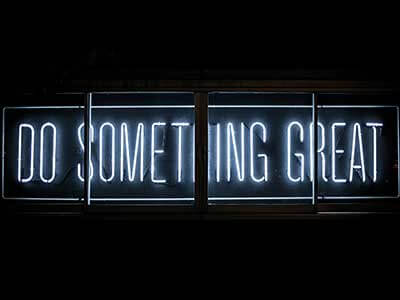 Do Something Great white neon sign on a black background | Digital Marketing Skills blog post by Trademark Productions