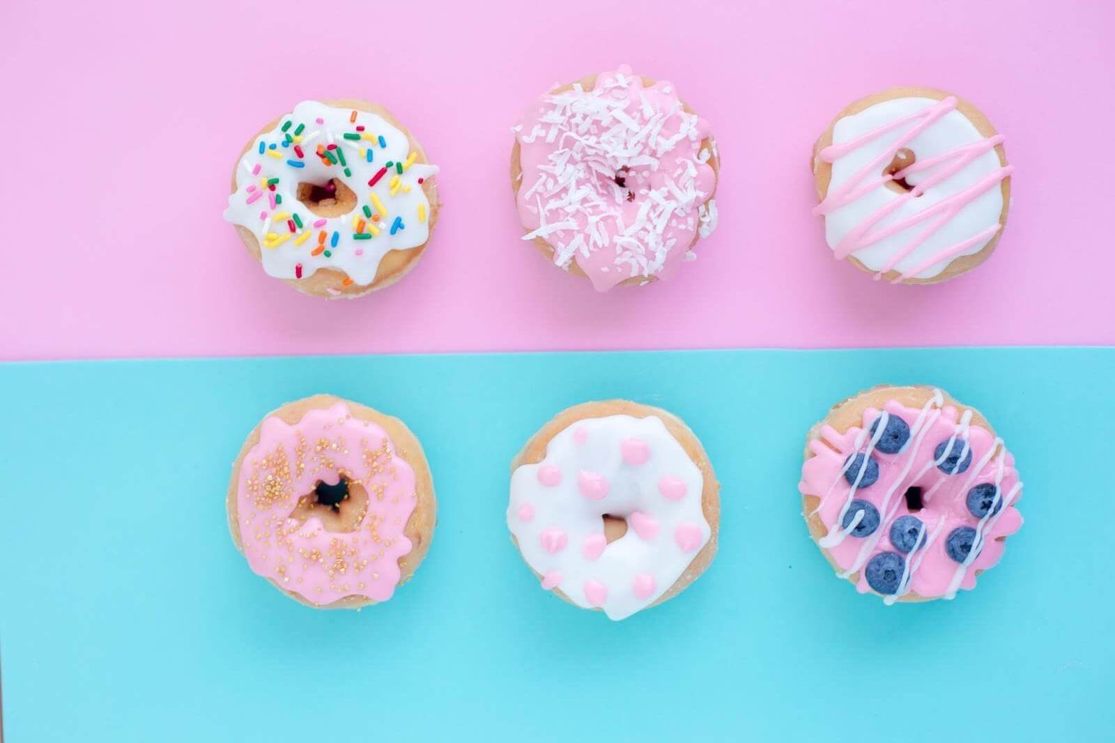 6 donut on a pink and blue background with toppings and sprinkles on them | Hick's Law