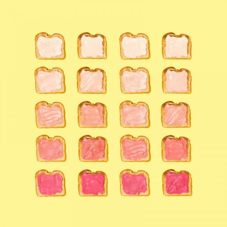 Various slices of toast with varying pink colors of jam | Hick's Law